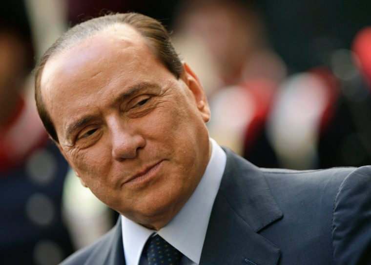 File photo of Italy's then PM Berlusconi during a meeting with Palestinian President Mahmoud Abbas at Chigi palace in Rome