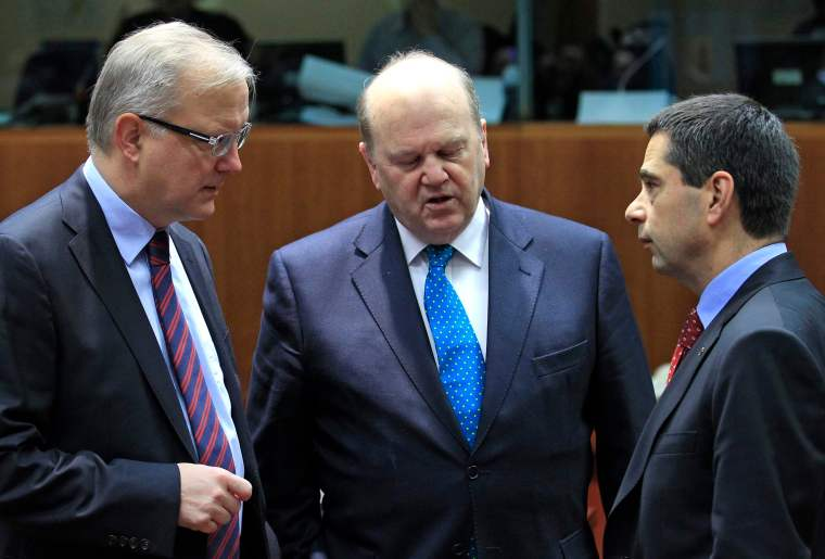 European Economic and Monetary Affairs Commissioner Rehn, Ireland's Finance Minister Noonan and Portugal's Finance Minister Gaspar attend a European Union finance ministers meeting in Brussels