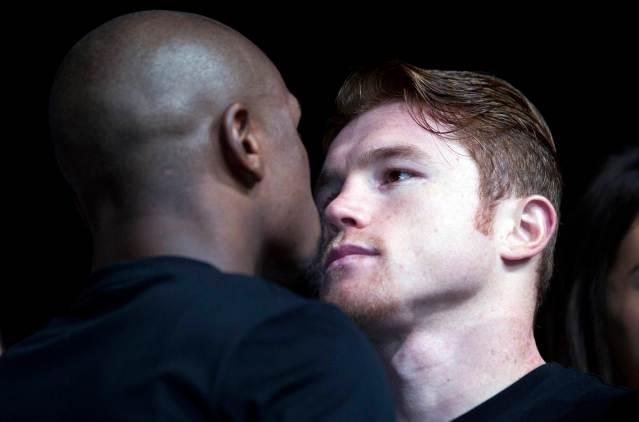Undefeated boxers Mayweather Jr of the US and Alvarez of Mexico face off during a news conference in Las Vegas