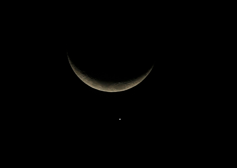 A view of the crescent moon and planet Venus in the sky over Buenos Aires